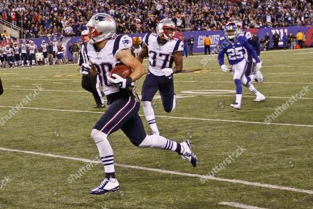 New England Patriots' Danny Amendola (80) runs away from New York Giants' Tramain Jacobs (25) during the second half of an NFL football game, in East Rutherford, N.J