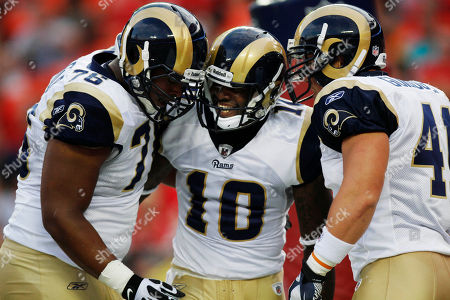 Mike Sims-Walker, Rodger Saffold, Ben Guidugli. St. Louis Rams wide receiver Mike Sims-Walker (10) celebrates a touchdown with offensive tackle Rodger Saffold (76) and tight end Ben Guidugli (41) during the first half of a preseason NFL football game against the Kansas City Chiefs at Arrowhead Stadium in Kansas City, Mo
