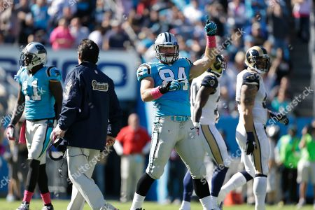 Ben Hartsock, Jeff Fisher. Carolina Panthers' Ben Hartsock (84) celebrates the ejection of a St. Louis player as Rams' head coach Jeff Fisher looks for an official to complain to during the second half of an NFL football game in Charlotte, N.C., . The Panthers won 30-15