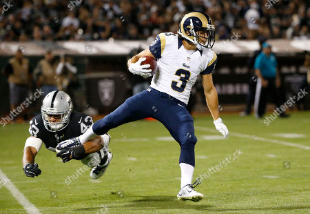 Jimmy Hall, Daniel Rodriguez. St. Louis Rams wide receiver Daniel Rodriguez (3) runs past Oakland Raiders linebacker Jimmy Hall (43) during the second half of an NFL preseason football game in Oakland, Calif. Long after the rest of the St. Louis Rams have left the practice field, Daniel Rodriguez drips with sweat running dozens of extra pass routes from backup quarterback Austin Davis. No one can tell the fearless 27-year-old rookie with the unique back story, a decorated Army veteran, that he's nothing more than a training camp feel-good story