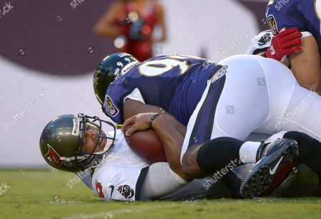 Josh Freeman, Chris Canty. Tampa Bay Buccaneers quarterback Josh Freeman (5) is sacked by Baltimore Ravens defensive end Chris Canty (99) during the first half of an NFL preseason football game in Tampa, Fla