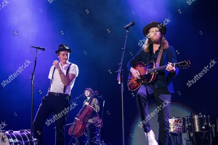 Jeremiah Caleb Fraites, Neyla Pekarek, Wesley Keith Schultz. Jeremiah Fraites, from left, Neyla Pekarek and Wesley Schultz of The Lumineers perform at the 2017 KROQ Almost Acoustic Christmas at The Forum, in Inglewood, Calif