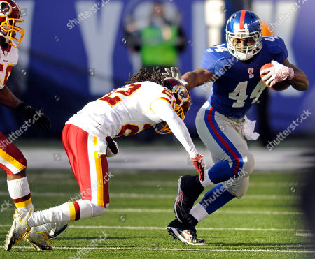 Ahmad Bradshaw, Kevin Barnes. New York Giants running back Ahmad Bradshaw, right, stiff arms Washington Redskins cornerback Kevin Barnes during the second quarter of an NFL football game, in East Rutherford, N.J