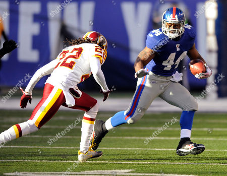 Ahmad Bradshaw, Kevin Barnes. New York Giants running back Ahmad Bradshaw, right, is pursued by Washington Redskins cornerback Kevin Barnes during the second quarter of an NFL football game, in East Rutherford, N.J