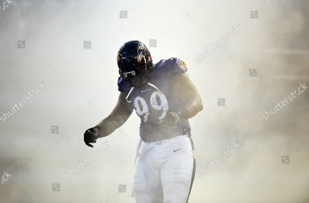 Baltimore Ravens defensive end Chris Canty runs onto the field as he is introduced before an NFL preseason football game against the Washington Redskins, in Baltimore