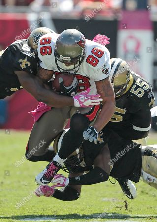 Jerramy Stevens, Jonathan Vilma, Roman Harper, Danny Clark. Tampa Bay Buccaneers tight end Jerramy Stevens (85) is stopped by New Orleans Saints defenders Danny Clark (55), Jonathan Vilma (51) and Roman Harper, bottom, in the first half of their NFL football game, in Tampa, Fla