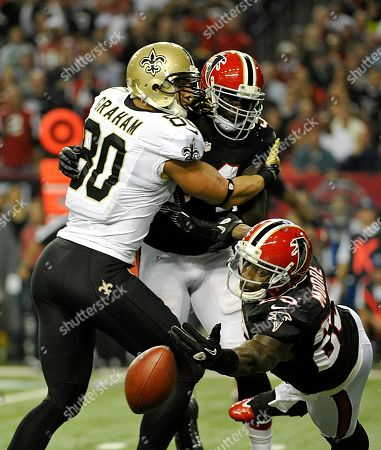 Jimmy Graham, Stephen Nicholas, William Moore. New Orleans Saints tight end Jimmy Graham (80) plays for the ball against the defense of Atlanta Falcons outside linebacker Stephen Nicholas, center, and strong safety William Moore, right, in the second half of an NFL football game, in Atlanta