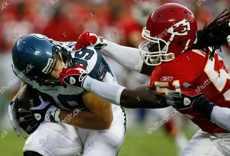 John Carlson, Corey Mays. Seattle Seahawks tight end John Carlson (89) is grabbed by Kansas City Chiefs linebacker Corey Mays (51) during the first half of their preseason NFL football game in Kansas City, Mo., . There was no call on the play