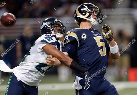 Cary Williams, Nick Foles. St. Louis Rams quarterback Nick Foles, right, fumbles as he is hit by Seattle Seahawks defensive back Cary Williams while throwing during the fourth quarter of an NFL football game, in St. Louis. Williams recovered the fumble and returned the ball for a touchdown