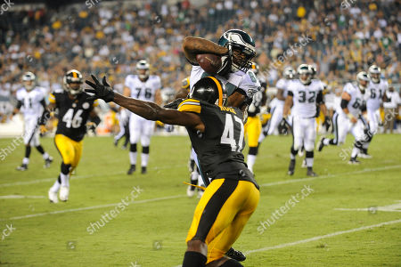 Jamel Hamler, Myrn Rolle. Philadelphia Eagles' Jamel Hamler rushes past Pittsburgh Steelers' Myron Rolle during an NFL preseason football game, in Philadelphia. The Eagles won 24-23