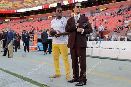 Stock Picture of Former NFL player Clinton Fortis and actor Michael McConaughey stand on the sidelines before an NFL football game between the Washington Redskins and the Pittsburgh Steelers in Landover, Md