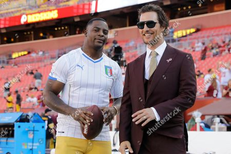 Former NFL player Clinton Fortis and actor Michael McConaughey stand on the sidelines before an NFL football game between the Washington Redskins and the Pittsburgh Steelers in Landover, Md
