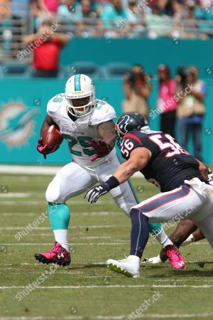 Jonas Gray runs the ball during an NFL football game between the Houston Texans and the Miami Dolphins, in Miami, FL