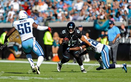 Will Ta'ufo'ou, Jordan Babineaux, Akeem Ayers. Jacksonville Jaguars running back Will Ta'ufo'ou (45) looks to get past Tennessee Titans strong safety Jordan Babineaux, right, and outside linebacker Akeem Ayers (56) during the first half of an NFL football game, in Jacksonville, Fla