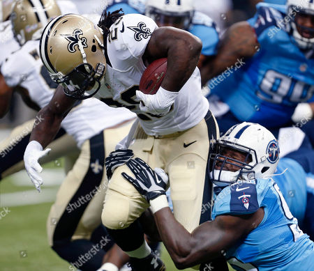 Khiry Robinson, Kamerion Wimbley. New Orleans Saints running back Khiry Robinson (29 is tackled on a carry by Tennessee Titans defensive end Kamerion Wimbley (95) in the first half of an NFL preseason football game in New Orleans