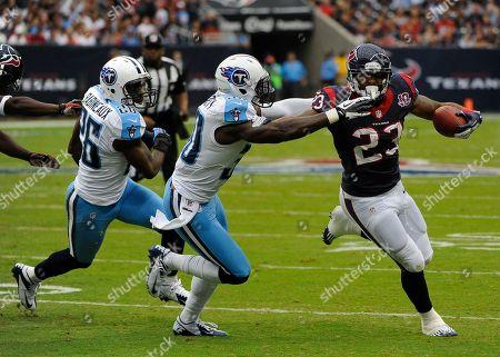 Arian Foster, Jason McCourty, Jordan Babineaux. Houston Texans' Arian Foster (23) runs from Tennessee Titans Jason McCourty (30) and Jordan Babineaux (26) in the first quarter of an NFL football game, in Houston