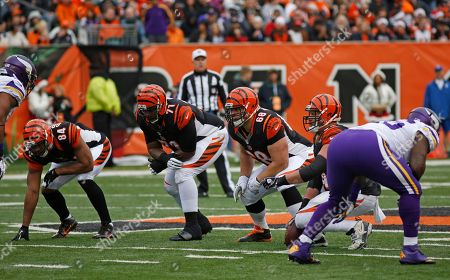 Jermaine Gresham, Andre Smith, Kevin Zeitler, Kyle Cook. Cincinnati Bengals tight end Jermaine Gresham (84), tackle Andre Smith (71), guard Kevin Zeitler (68) and center Kyle Cook line up against the Minnesota Vikings in an NFL football game, in Cincinnati
