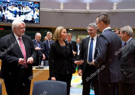 European Union foreign policy chief Federica Mogherini, center, speaks with Hungarian Foreign Minister Peter Szijjarto, third right, and Polish Foreign Minister Witold Waszczykowski, left, during a meeting of EU foreign ministers at the Europa building in Brussels on . Israeli Prime Minister Benjamin Netanyahu urged the European Union on Monday to back a new U.S. peace initiative in the Middle East, after President Donald Trump's unilateral decision to recognize Jerusalem as Israel's capital met with widespread condemnation and triggered clashes in the Palestinian territories