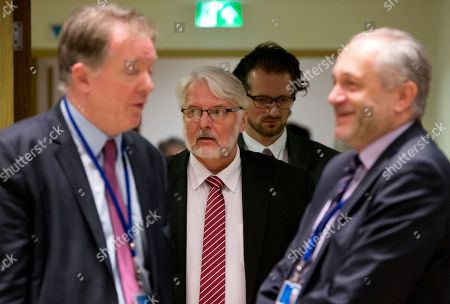 Polish Foreign Minister Witold Waszczykowski, center, arrives for a meeting of EU foreign ministers at the Europa building in Brussels on . Israeli Prime Minister Benjamin Netanyahu urged the European Union on Monday to back a new U.S. peace initiative in the Middle East, after President Donald Trump's unilateral decision to recognize Jerusalem as Israel's capital met with widespread condemnation and triggered clashes in the Palestinian territories