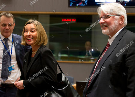 European Union High Representative Federica Mogherini, second left, walks with Polish Foreign Minister Witold Waszczykowski during a meeting of EU foreign ministers at the Europa building in Brussels on . Israeli Prime Minister Benjamin Netanyahu urged the European Union on Monday to back a new U.S. peace initiative in the Middle East, after President Donald Trump's unilateral decision to recognize Jerusalem as Israel's capital met with widespread condemnation and triggered clashes in the Palestinian territories