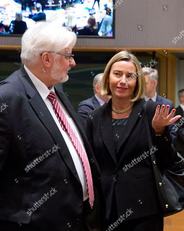 European Union foreign policy chief Federica Mogherini, right, speaks with Polish Foreign Minister Witold Waszczykowski during a meeting of EU foreign ministers at the Europa building in Brussels on . Israeli Prime Minister Benjamin Netanyahu urged the European Union on Monday to back a new U.S. peace initiative in the Middle East, after President Donald Trump's unilateral decision to recognize Jerusalem as Israel's capital met with widespread condemnation and triggered clashes in the Palestinian territories