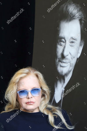 French singer Sylvie Vartan arrive at French rock star Johnny Hallyday's funeral ceremony in Paris, Saturday, Dec.9, 2017. France is bidding farewell to its biggest rock star, honoring Johnny Hallyday with an exceptional funeral procession down the Champs-Elysees, a presidential speech and a motorcycle parade, all under intense security