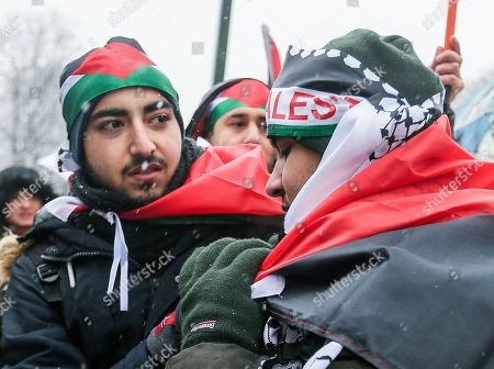 People hold the Palestinian flags as they gather to protest the arrival of Israeli Prime Minister Benyamin Netanyahu on Belgian and European soil, at the European District in Brussels, Belgium, 11 December 2017. Netanyahu arrives in Brussel during the EU-Israel foreign affair meeting where he seeks the EU Jerusalem recognition, after US President Donald J. Trump recognized Jerusalem as a capital of Israel.