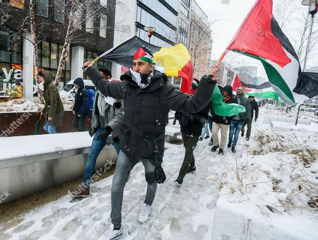 People hold the Belgium and Palestinian flags as they gather to protest the arrival of Israeli Prime Minister Benyamin Netanyahu on Belgian and European soil, at the European District in Brussels, Belgium, 11 December 2017. Netanyahu arrives in Brussel during the EU-Israel foreign affair meeting where he seeks the EU Jerusalem recognition, after US President Donald J. Trump recognized Jerusalem as a capital of Israel.