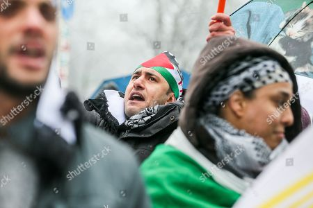 A demonstrator shouts slogans to protest the arrival of Israeli Prime Minister Benyamin Netanyahu on Belgian and European soil, at the European District in Brussels, Belgium, 11 December 2017. Netanyahu arrives in Brussel during the EU-Israel foreign affair meeting where he seeks the EU Jerusalem recognition, after US President Donald J. Trump recognized Jerusalem as a capital of Israel.