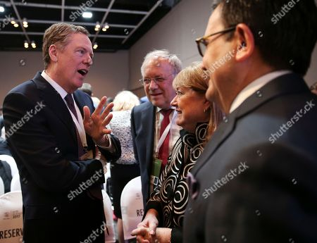 U.S. Trade Representative Robert Lighthizer, from left, Swiss federal councillor Johann Schneider-Ammann, President of the eleventh Ministerial Conference of the World Trade Susana Malcorra and Mexico's Secretary of Economy Ildefonso Guajardo Villarreal, talk before the conference in Buenos Aires, Argentina