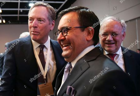 U.S. Trade Representative Robert Lighthizer, left, Mexico's Secretary of Economy Ildefonso Guajardo Villarreal, center, and Switzerland's Johann Schneider-Ammann, gather for before the start of the Ministerial Conference of the World Trade Organization in Buenos Aires, Argentina