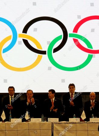 Paraguayan President Horacio Cartes (C), accompanied by the Minister of the Sports Secretariat Victor Pecci (C-R), the president of the Uruguayan Olympic Committee Julio Maglione (R), the President of the Olympic Comitte Camilo Perez (C-L) and the President of the Organization of Chilean Sports Pan Am Naven Ilic (L) attend  the 30th Ordinary General Assembly of the Odesur (Organizacion Deportiva Suramericana) in Asuncion, Paraguay, 11 December 2017. The assembly will choose the headquarters of the 2022 South American Games.