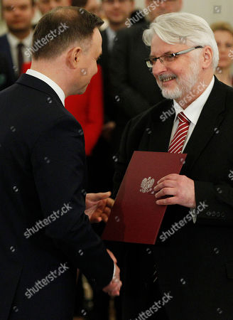 Andrzej Duda, Witold Waszczykowski. Polish President Andrzej Duda, left, nominates Witold Waszczykowski as new Minister of Foreign Affairs at the Presidential Palace in Warsaw, Poland