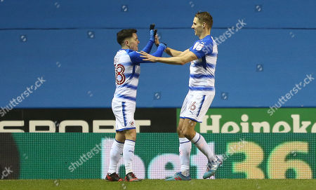 Yann Kermorgant and David Edwards of Reading celebrate after Callum Paterson of Cardiff City scores a own goal.