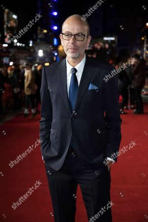 Eric Fellner poses for photographers upon arrival at the premiere of the film 'Darkest Hour', in London
