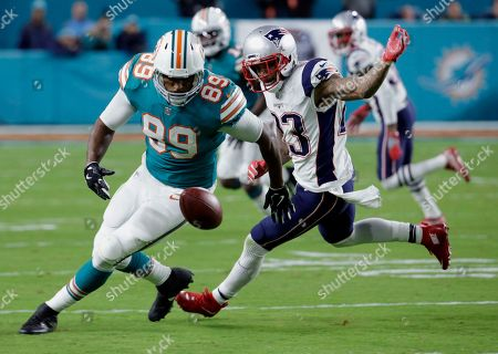 Julius Thomas, Patrick Chung. Miami Dolphins tight end Julius Thomas (89) drops a pass but recovers it as New England Patriots strong safety Patrick Chung (23) defends, during the first half of an NFL football game, in Miami Gardens, Fla