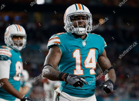 Jarvis Landry, Julius Thomas. Miami Dolphins wide receiver Jarvis Landry (14) celebrates his touchdown during the second half of an NFL football game against the New England Patriots, in Miami Gardens, Fla. Behind Landry isMiami Dolphins tight end Julius Thomas (89