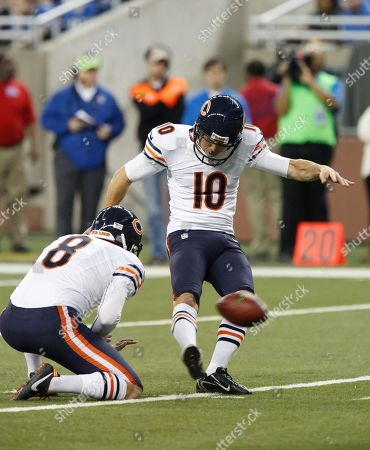 Stock Photo of Chicago Bears kicker Olindo Mare (10) kicks during the fourth quarter of an NFL football game against the Detroit Lions at Ford Field in Detroit