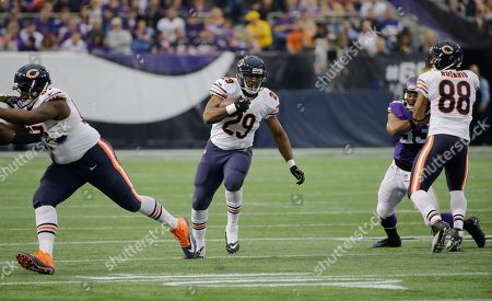 Chicago Bears running back Michael Bush (29) carries the ball during the first half of an NFL football game against the Minnesota Vikings, in Minneapolis