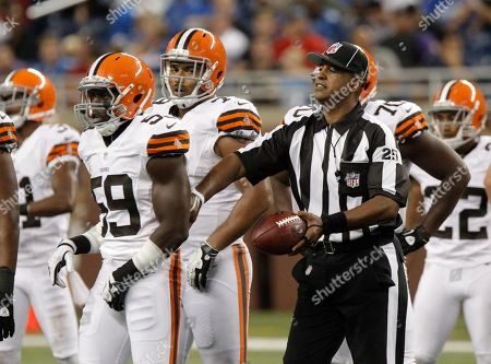 Hugh Douglass, Emmanuel Acho. NFL umpire Hugh Douglass, right, and Cleveland Browns linebacker Emmanuel Acho (59) in an NFL preseason football game against the Detroit Lions, in Detroit