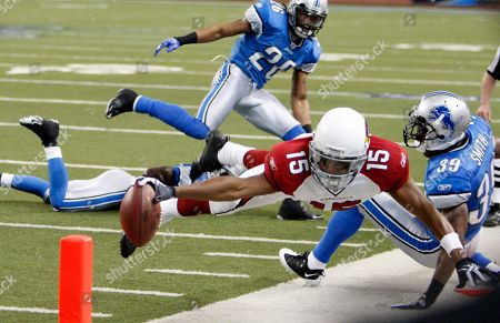 Steve Breaston, DeAngelo Smith. Arizona Cardinals wide receiver Steve Breaston (15) reaches for the end zone as he's pushed out of bounds by Detroit Lions cornerback DeAngelo Smith (39) during the first quarter of an NFL football game at Ford Field in Detroit