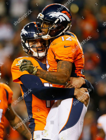 Brock Osweiler, Andre Caldwell. Denver Broncos quarterback Brock Osweiler (17) and Andre Caldwell (12) celebrate their touchdown during the second half of an NFL football game against the Kansas City Chiefs, in Denver