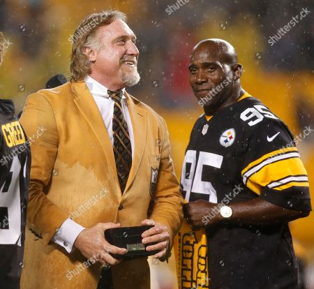 Kevin Greene, Greg Lloyd. Pro Football Hall of Fame class of 2016 inductee and former Pittsburgh Steelers linebacker Kevin Greene, left, is joined by Steelers teammate Greg Lloyd, right, during a half-time ceremony to present him with his Hall of Fame ring during a football game between the Pittsburgh Steelers and the Kansas City Chiefs in Pittsburgh