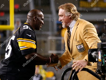 Kevin Greene, Greg Lloyd. Pro Football Hall of Fame class of 2016 inductee and former Pittsburgh Steelers linebacker Kevin Greene, right, is joined by Steelers teammate Greg Lloyd, left, during a half-time ceremony to present him with his Hall of Fame ring during a football game between the Pittsburgh Steelers and the Kansas City Chiefs in Pittsburgh