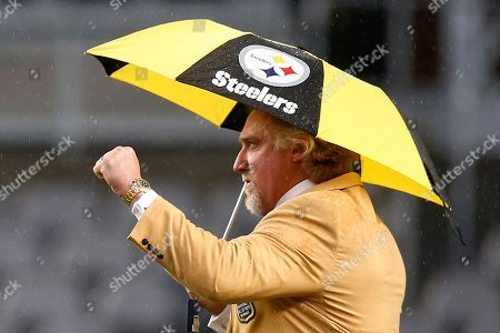 Pro Football Hall of Fame class of 2016 inductee and former Pittsburgh Steelers linebacker Kevin Greene walks on the field at Heinz Field before a football game between the Pittsburgh Steelers and the Kansas City Chiefs in Pittsburgh, . Greene will receive his hall of fame ring during a half-time ceremony