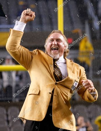 Pro Football Hall of Fame class of 2016 inductee and former Pittsburgh Steelers linebacker Kevin Greene holds up his Hall of Fame ring after receiving it during a half-time ceremony during a football game between the Pittsburgh Steelers and the Kansas City Chiefs in Pittsburgh