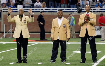 Lem Barney, Barry Sanders, Charlie Sanders. Former Detroit Lions and NFL Hall of Fame members, from left, Lem Barney, Barry Sanders and Charlie Sanders are introduced during an alumni celebration at half time of the Detroit Lions NFL football game against the Dallas Coyboys in Detroit