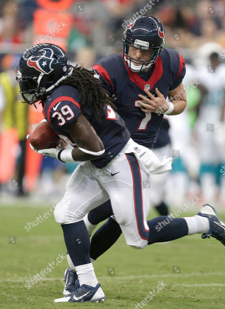Case Keenum, Deji Karim. Houston Texans quarterback Case Keenum (7) hands off the ball to running back Deji Karim (39) during the first half of a preseason NFL football game, in Houston