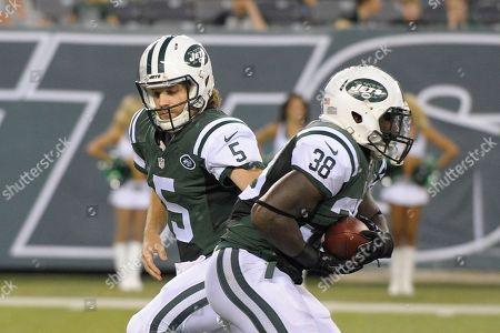 Matt Flynn, Zac Stacy. New York Jets' Matt Flynn (5) hands the ball to New York Jets' Zac Stacy (38) during the first half of a preseason NFL football game in East Rutherford, N.J