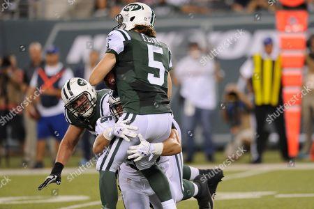 New York Jets tackle Brent Qvale (79) watches as Philadelphia Eagles linebacker Bryan Braman (56) sacks quarterback Matt Flynn (5) during the first half of a preseason NFL football game in East Rutherford, N.J